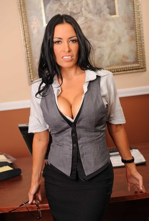 Dark haired business woman Vanilla Deville exposes her big tits in her office