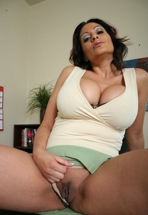 Latina Ava Lauren gets bored in her work suit, so she flashes her big tits