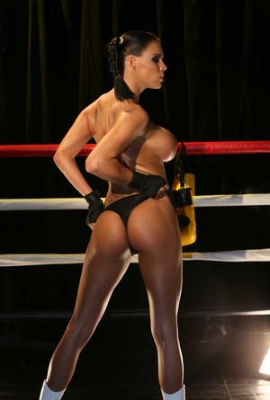 Brunette Peta Jensen shining her big tits and juicy pussy in the fight ring