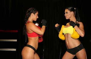 Peta Jensen and Eva Lovia face off each other's big boobs before the fight