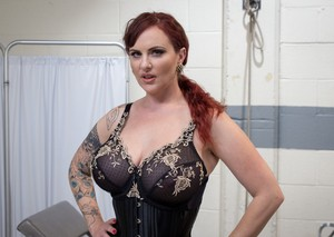 Redhead Domme Mz Berlin awaits your anus in sexy lingerie and a lab coat
