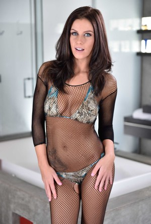 Brunette female Whitney Westgate takes off a crotchless bodystocking