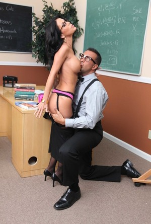 Brunette teacher makes the class clown fuck her in front of the class