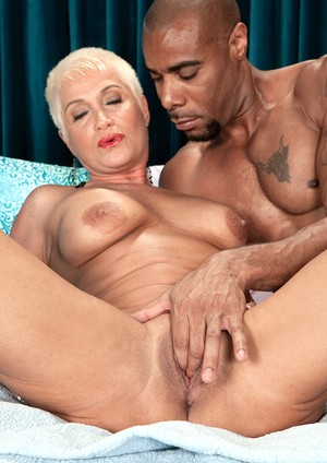 Mature MILF Trinity Powers gets shagged by a black cock before her facial