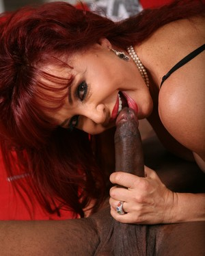 Redhead cougar Sexy Vanessa gets a big black cock shoved into her pussy