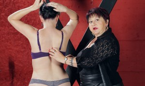 Clothed BBW Cleo Dubois demonstrates flogging styles upon Nerine Mechanique