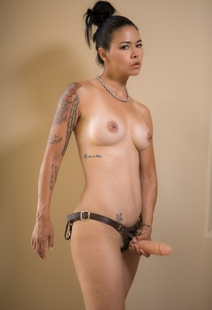 Solo model Dana Vespol affixes a strapon cock to her naked body