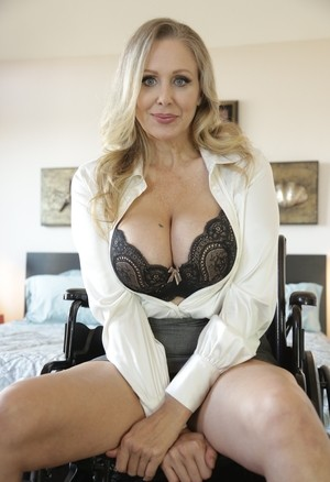 Middle-aged American lady Julia Ann uncovers her hug boobs as she undresses