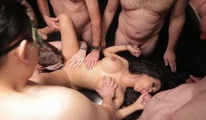 White slut perfects her cum swallowing skills during a gangbang
