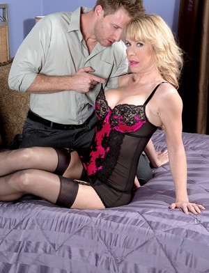 Smoking granny Desiree Dalton wears some stockings before he plunges her cunt