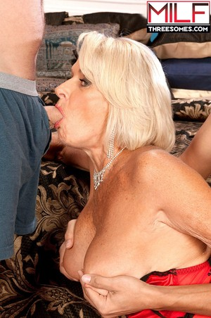 Older white lady Georgette Parks  bangs 2 younger boys at the same time