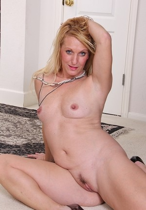 Mature blonde Brooke Harper spreads her hairy pussy before getting unclothed