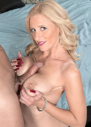 Holly Claus gives a blowjob and titty-fucking before getting banged roughly