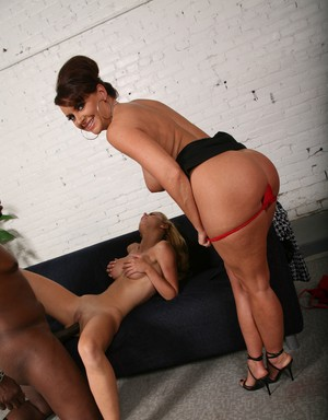 Mom and daughter duo take their turns having sex with a big black dick