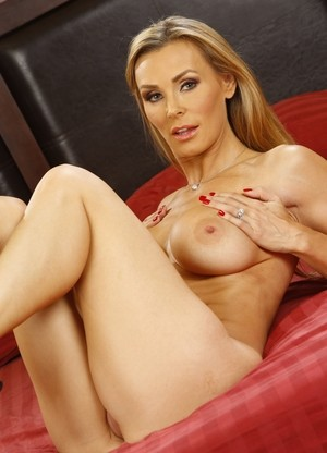 Hot blonde chick Tanya Tate takes off her short dress atop her bed
