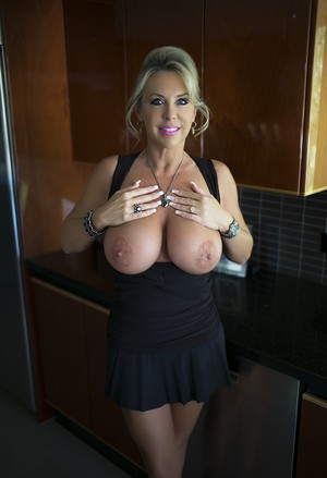 Astounding MILF Sandra Otterson lets her big natural boobs breath