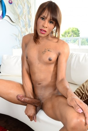 Black shemale Chyna sticks out heer tongue while jerking her massive dick