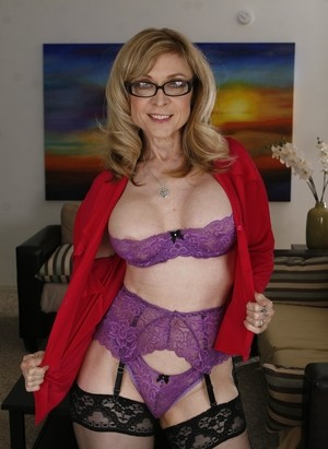 Stunning MILF Nina Hartly in stockings and lingerie displays her goods