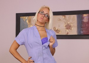 Blonde masseuse Blake Carter restrains a man and starts jacking his dick