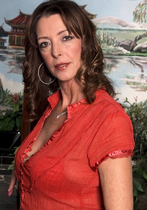 Older lady Lucy Holland sports a pearl necklace after having sex