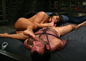 Dominant woman with wide hips Sandra Romain blows and jerks tied up man's cock