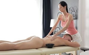 Brunette masseuse likes the look of a big white cock while giving a masssage