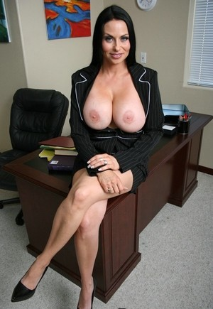 Stunning business woman Harley Rain takes out her big tits in the office