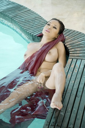 Asian model Kim Tao shows off her flawless big boobs and shaved pussy in pool