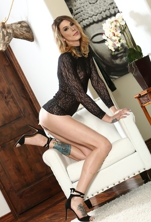 Leggy shemale Casey Kisses slides her thong over her hard cock in heels