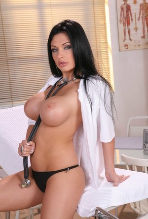 Solo model with black hair Aletta Ocean ditches her lab coat to pose nude