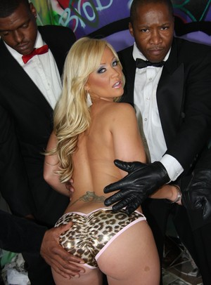 Blond chick Austin Taylor gets jizz on her face during an interracial gangbang