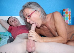 Nerdy granny Leilani Lei bends over and gives a horny stud a killer BJ