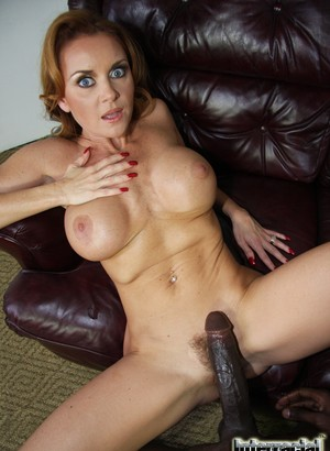 Big tit redhead MILF Janet Mason moans while riding a BBC on the sofa