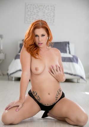 Wonderful ginger Edyn Blair strips down to her high heels and poses