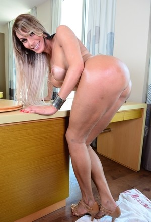 Latina shemale with muscled tanned body and erect dick Camyle Victoria