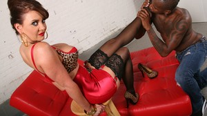 Busty mistress Janet Mason gives her black slave a perfect footjob