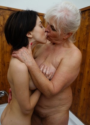 Old and young lesbians Juliene and Kaitlyn pleasure each others slits