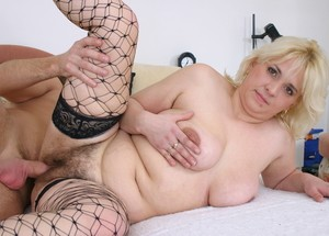 Hot blonde babe Sophy in fishnets gets a big cock into her mouth