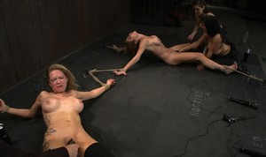 Big tit female slaves get their snatches toyed up in lesbian domination scene