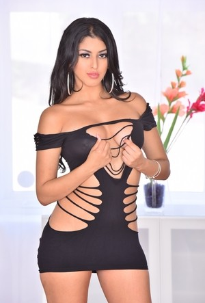 Stunning Latina Sophia Leone strips off her slutty outfit and spreads her muff
