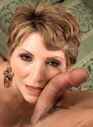 Short haired mature woman Bea Cummins gives a titjob & blowjob in POV