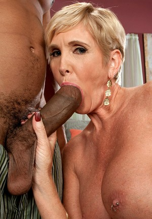 Short-haired blonde mature with big tits Honey Ray banged by heavy black dick