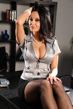 Attractive big breasted secretary Ava Addams goes topless at the office