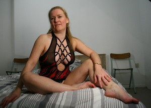 Mature housewife Martine B shows her shaved pussy while masturbating