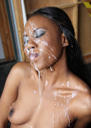 Ebony in sexy outfit Nina Devon gets her mouth fucked and sprayed by white men