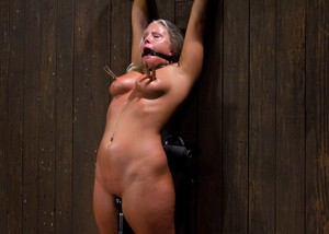 Fat chick Kait Snow drools while being tortured against the wall