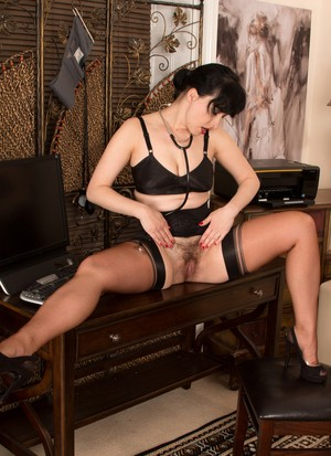 Lusty doctor Nikkita strips her sexy uniform off and poses in her lingerie