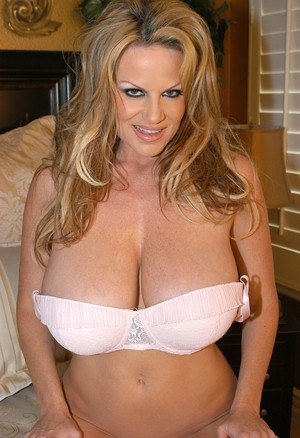 Astounding blonde MILF shows her big tits before she uses a dildo on her slit