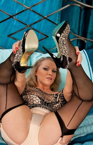 Incredible MILF Abi Toyne displays her tits and her feet while in lingerie