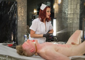 Redhead nurse Maitresse Madeline Marlowe uses BDSM tools on her patient